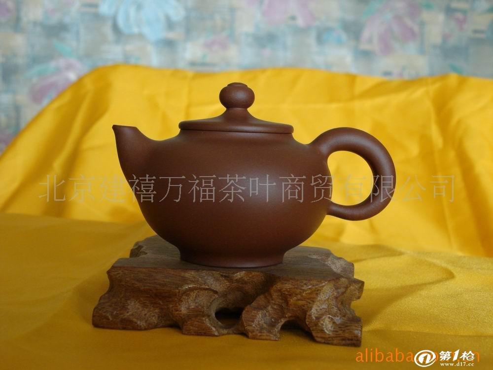 1991年设计制作的[鸿运茶具]获浙江省文化节优秀茶具奖.